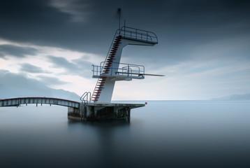 View of footbridge at Lake Geneva against cloudy sky