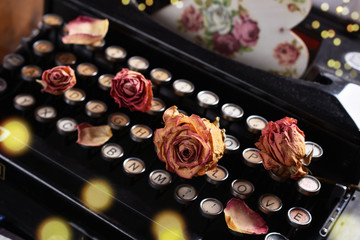 vintage love with dried roses and typewriter