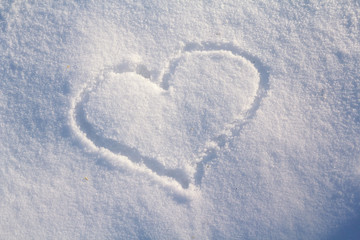 Figure of eight written in the snow in the painted heart. Snow texture