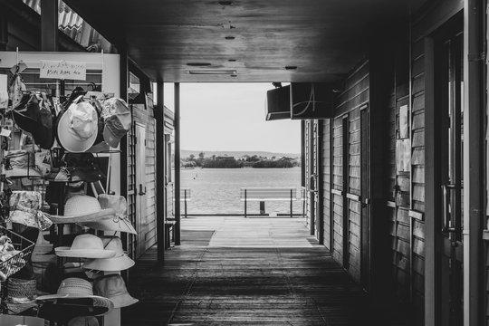 Shops at docks in Perth at Elizabeth Quay in Western Australia in black and white