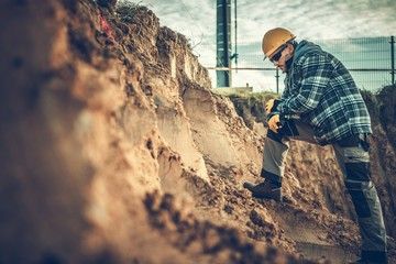 Worker Checking on a Soil Wall mural