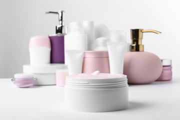 Different body care products on white background