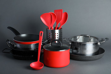 Set of modern clean kitchenware on color background