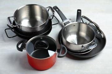 Set of modern clean kitchenware on light background