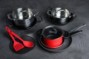 Set of modern clean kitchenware on color background