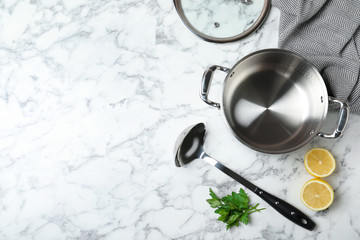 Flat lay composition of clean kitchenware on marble background. Space for text