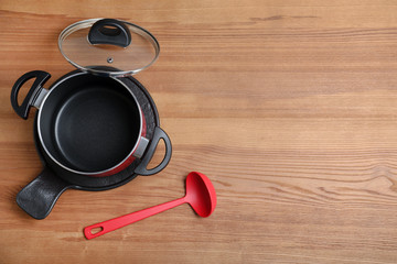 Flat lay composition of clean kitchenware on wooden background. Space for text