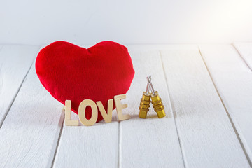 Valentines Day background with Red Heart shape and Couple Combination golden padlock on white wooden table