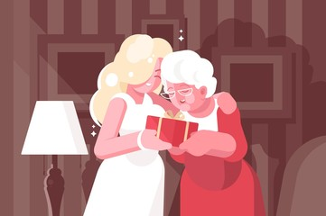 Blonde woman giving present to her mother