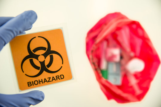Disposal container; reducing medical waste disposal. Small Medical Waste sharps container with sharps for biohazand.