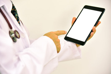 Close-up of doctor hands using smartphone for order antibiotic in hospital network or social networks concept, man typing an sms message to his friends.