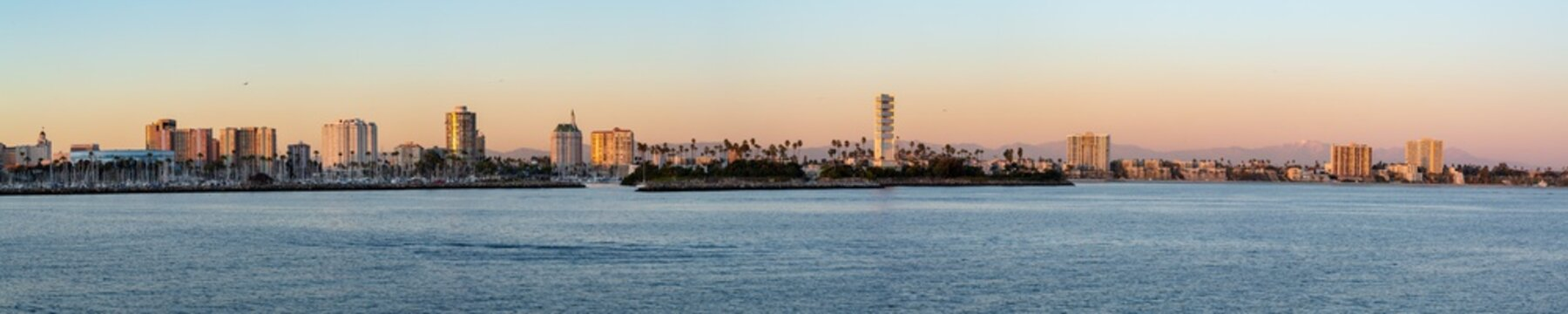 Panorama of Long Beach harbor as seen from a boat at sunset.