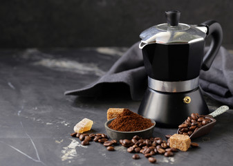 still life of coffee, grains and ground on a black background