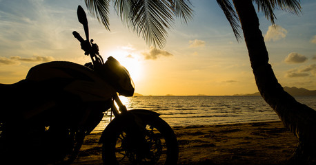 Road Bike Motorcycle Silhouette Parked With Palm Tree on Sunset Beach - El-Nido, Palawan - Philippines