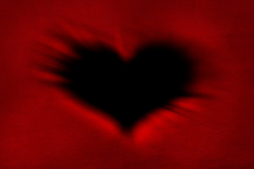 Heart-shaped black hole on a red background for Valentine