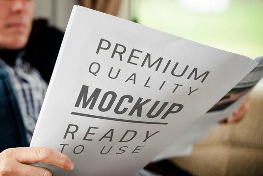 Man holding a premium quality paper mockup