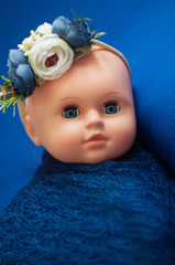 Baby doll toy photodraphed in a newborn style.