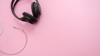 Wall Mural - Headphones and charge on pink background