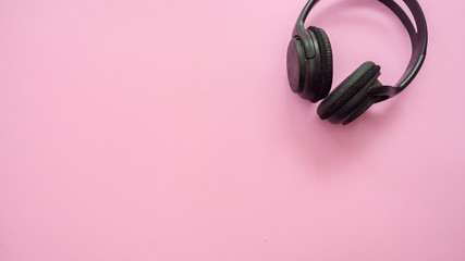Wall Mural - Headphones copy space on pink background