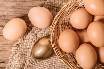 brown and golden chicken eggs
