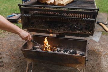 Man's hand preparing preparing for grilling