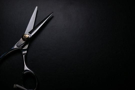 professional scissors on black background