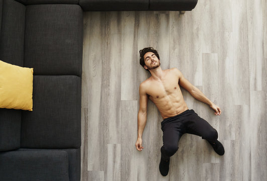 Muscular Handsome Young Man Sleeping After Working Out at Home