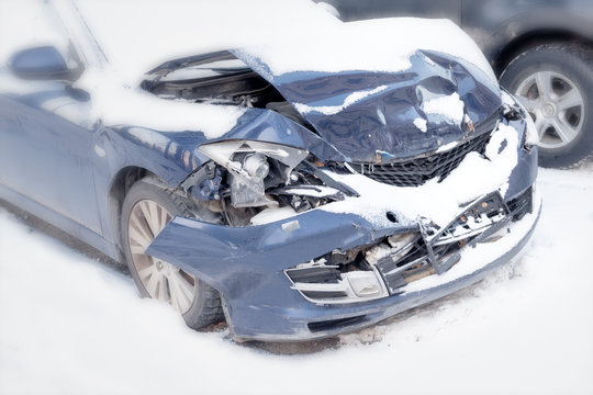 modern car wreck damaged after winter crash on street traffic collision in bad weather storm road damage auto insurance broken metal scene