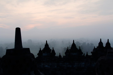 Silhouette Borobudur Temple with the mysteries forest surrounding at dawn, Yogyakarta, Indonesia