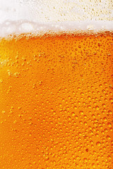Texture of light filtered beer close up