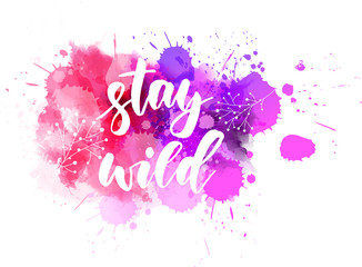 Stay wild lettering on watercolor splash