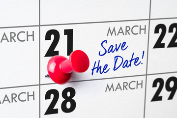 Wall calendar with a red pin - March 21