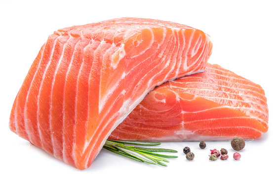 Fresh raw salmon fillets on white background.