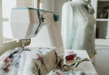 Dummy with blouse near sewing machine