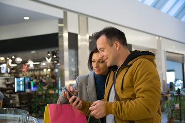 My friend famous stock photographer in shopping mall with his wife - Image