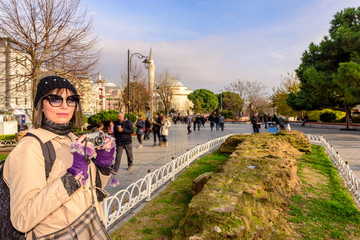 Beautiful woman takes pictures in Istanbul,Turkey