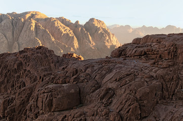 Stunning landscape of rocky peaks against a blue sky. Mount Sinai (Mount Horeb, Gabal Musa). Sinai Peninsula of Egypt. Famous touristic place and travel destination in Egypt