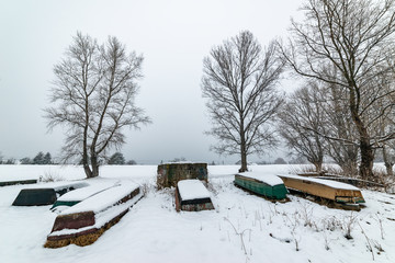 A boats covered with snow on the coast