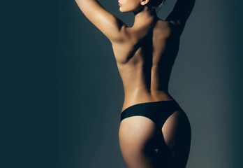 Cellulite - skin problem and body care. Big ass. Buttocks after treatment. Woman in erotic underwear. Buttocks of girl in pants. Sexy woman. Fitness and diet. Sexy female fetish-wear. Beautiful body