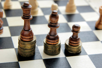 Chess and stack of coins in concept of money power or saving money,  business finance wealth and success, financial growth