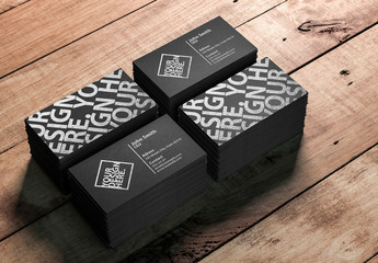 4 Stacks of Business Cards on a Wooden Table Mockup