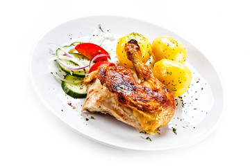 Grilled chicken leg with vegetables on white background