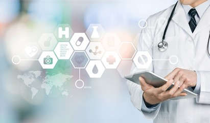 Close-up of male Doctor with stethoscope holding digital tablet