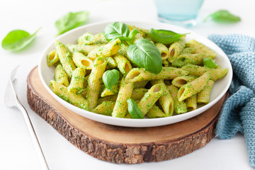 Wall Mural - penne pasta with spinach basil pesto sauce