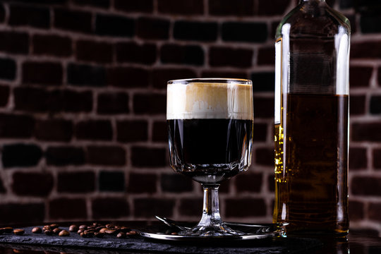 Irish coffee in a bar. Concept of St Patrick holiday. Holiday background. Irish national day. Warm tone. Square