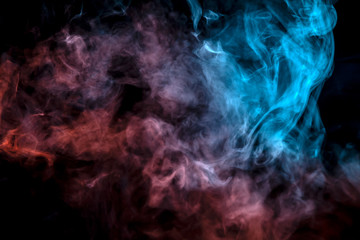The exhaled column of vapor illuminated with blue and pink light evaporates in thin streams against a black background as it clumps into smoke.