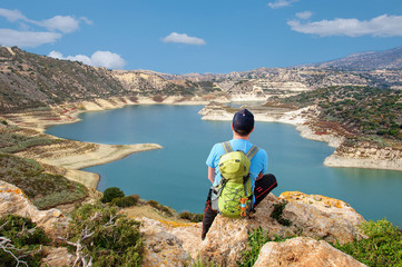 Wall Murals Cyprus tourist with backpack looks at a beautiful reservoir from a viewing platform in Cyprus