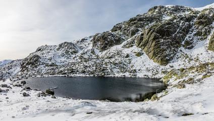 Glacial lagoon in the mountains of Madrid called Laguna Grande de Peñalara