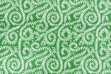 Background with white squiggle design on green