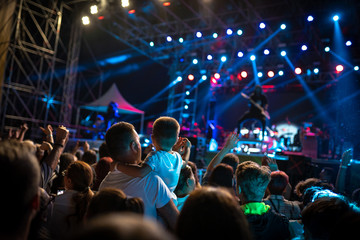 Crowded concert for adults and children alike
